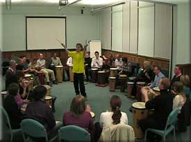 A fun drumming workshop in an ideal conference room.