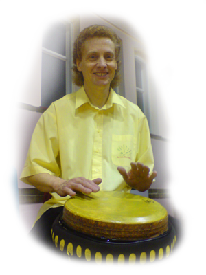 Steve Parker playing his djembe in a youth drumming workshop.